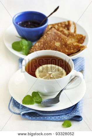 Cup Of Lemon Tea And Crepes With Jam