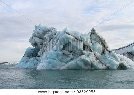 Large Blue Iceberg In Jokulsarlon Lake