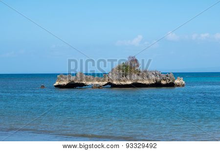 Small Rocky Island Near Shore Of Beach In Caramoan