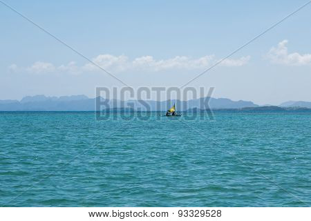 Single Fishing Boat In Blue Water Of Philippines