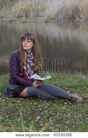 Girl With A Book By The Lake