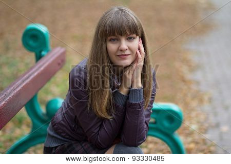 Girl On A Bench In The Autumn Park