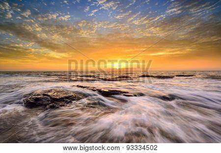 The Wave Flows Over Weathered Rocks And Boulders At North Narrabeen Rockshelf In Sunrise. Sydney Aus
