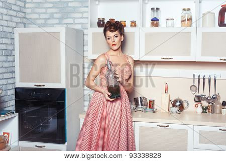 Woman Housewife In The Kitchen.