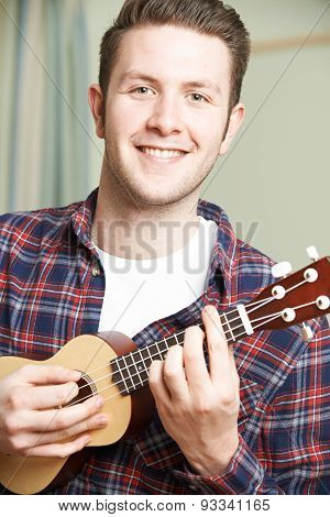 Portrait Of Man Playing Ukulele