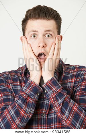 Studio Portrait Of Man With Shocked Expression
