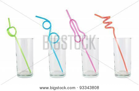 Tall empty glass with a straw