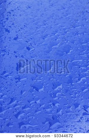 Pattern Of Raindrops On Blue Surface