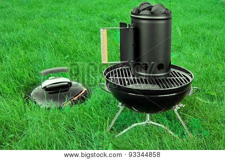 Bbq Kettle Grill With Charcoal Briquettes Starter On The Lawn