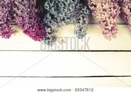 Lilac blossom on rustic wooden background with empty space for greeting message