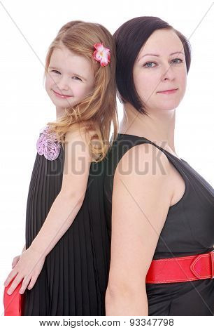 Closeup of elegant fashion mother and daughter