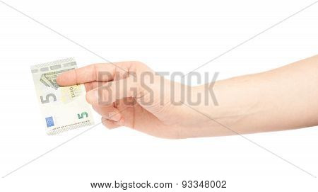 Hand holding five euro note isolated