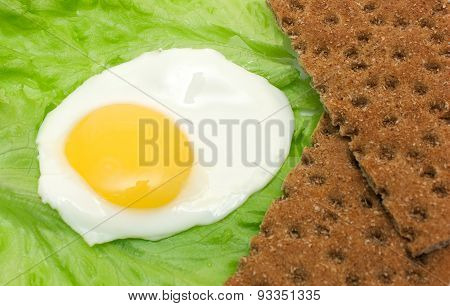 Healthy Food Background: Fried Eggs, Lettuce, Crisp Bread
