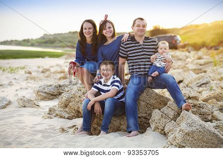 Family Of Five Having Fun On The Beach