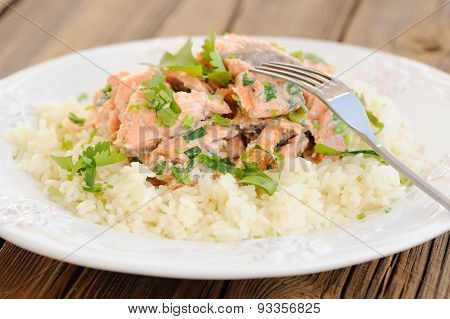 Salmon With Rice, Scallion And Cilantro In White Plate With Fork