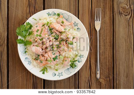 Salmon With Rice, Scallion And Cilantro In White Plate With Fork On Wooden Background Copyspace
