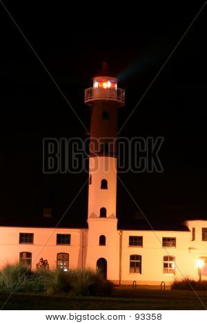 White Lighthouse Building At Night.