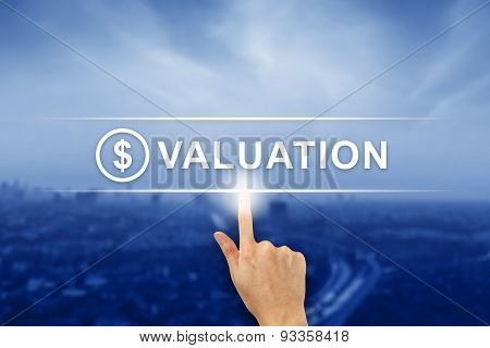 Hand Clicking Financial Valuation Button On Touch Screen
