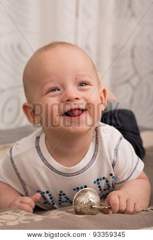 Portrait Of Cheerful Newborn Boy .