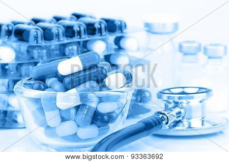 Oral Medications, Sterile Vials And Stethoscope On White Background.