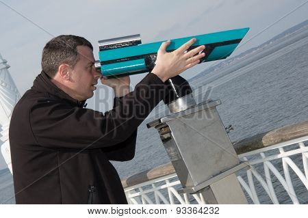 Confident  Man Tourist Watching Through  Telescope And Being Surprised