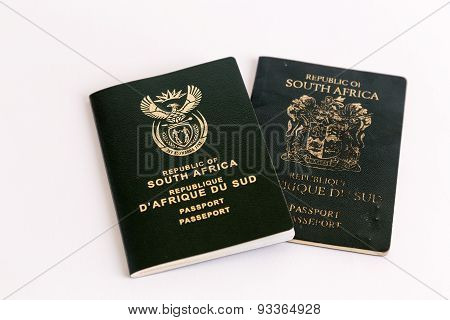 Old And New South African Passports On White Background