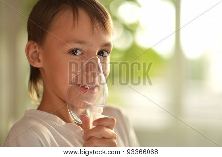Little boy holding inhaler