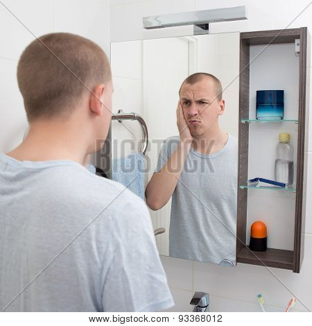 Hangover Concept - Tired Man Looking At Mirror In Bathroom