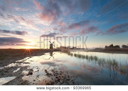 Beautiful Sunrise Over Windmill And River