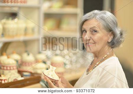beautiful senior woman at souvenir store