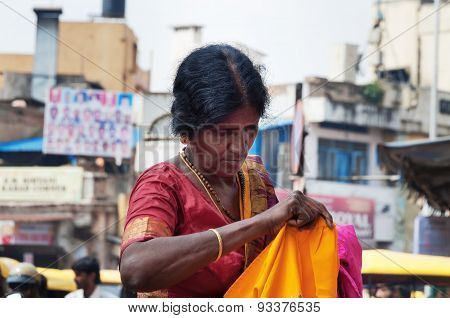 Indian Woman Chooses Clothes At The Russell Market In Bangalore
