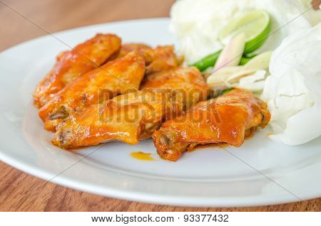 Bbq Chicken Wings On White Dish