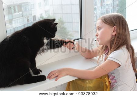 Little Girl Associates With Black Cat