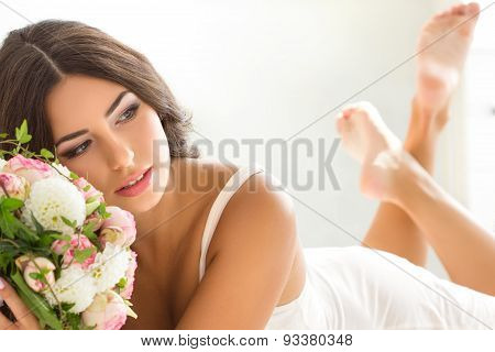 Beautiful Bride In White Lingerie Holding Nuptial Bouquet