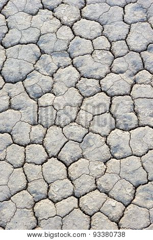 Extreme Closeup Of Dry And Cracked Mud Soil In Racetrack Playa In Death Valley National Park In Cali
