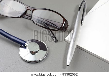 Stethoscope, Eye Glass, Pen And Book Note