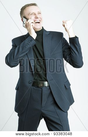 Handsome Caucasian Man In Elegant Siut Speaking Using Cell Phone