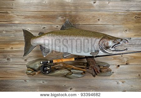 Trophy Salmon With Fishing Gear On Rustic Wood