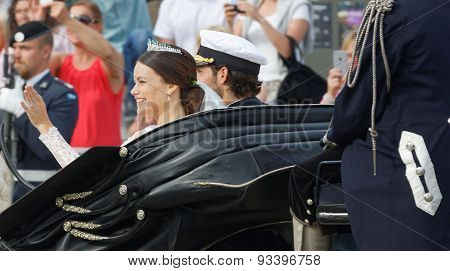 Rear View Of The Swedish Prince Carl-philip Bernadotte And His Wife Waving And Smiling