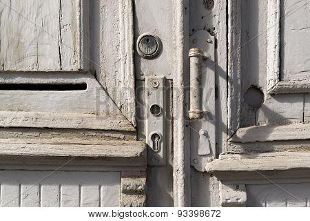 Grey Painted Old Wooden Doorhandle And Lock