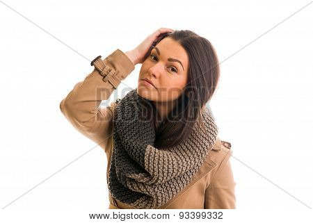 Young Woman With A Gray Scarf Is Looking Straight Ahead