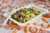 stock photo of gai  - Stir fried rice noodle with porkThai style - JPG