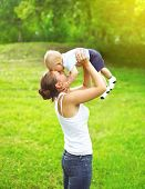 picture of mother baby nature  - Happy mother playing and having fun with baby outdoors in sunny summer day - JPG