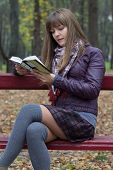 picture of straight jacket  - young girl reading a book on a bench - JPG