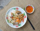 foto of nuong  - Pork grilled spring rolls and fresh sausages with rice noodle and vegetable Vietnamese typical cuisine so called BUN THIT NUONG - JPG
