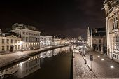 picture of gents  - The historical buildings of Gent in Belgium at night with reflections in the river Scheldt