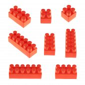 stock photo of brick block  - Set of plastic red toy construction block bricks in multiple foreshortenings - JPG