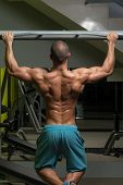 pic of pull up  - Young Male Athlete Doing Pull Ups  - JPG