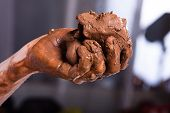 picture of molding clay  - raw clay in the hands of women - JPG