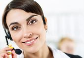 picture of helpdesk  - Female call center service operator at work - JPG
